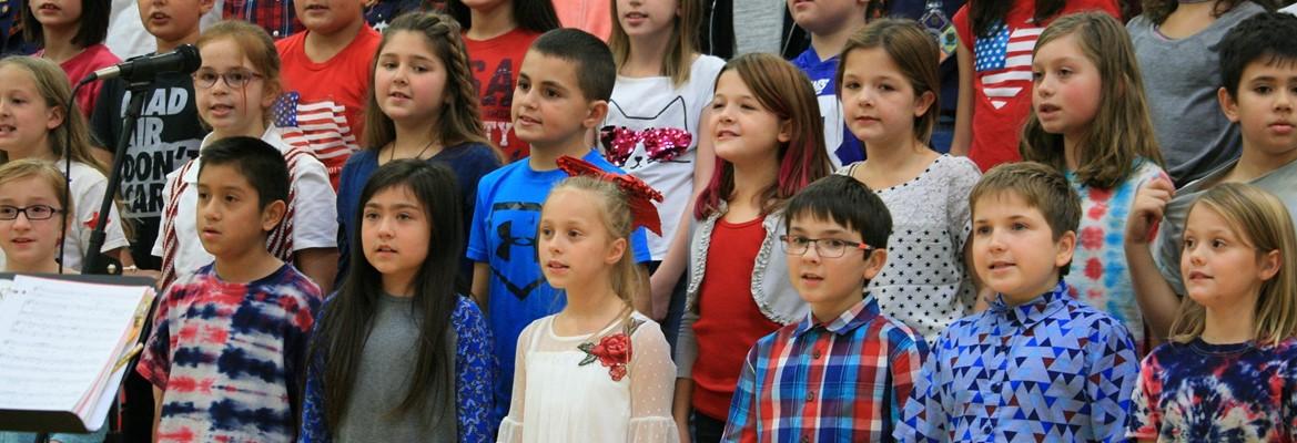 elementary chorus students singing