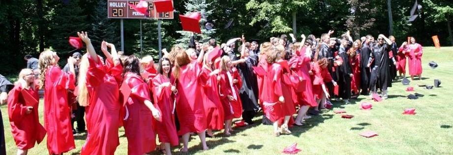graduates tossing caps in the air