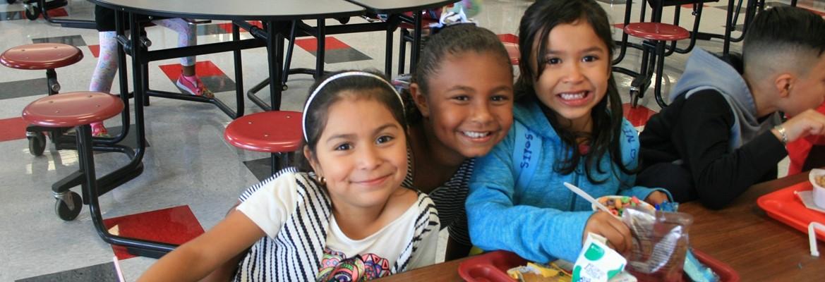 three girls eating breakfast