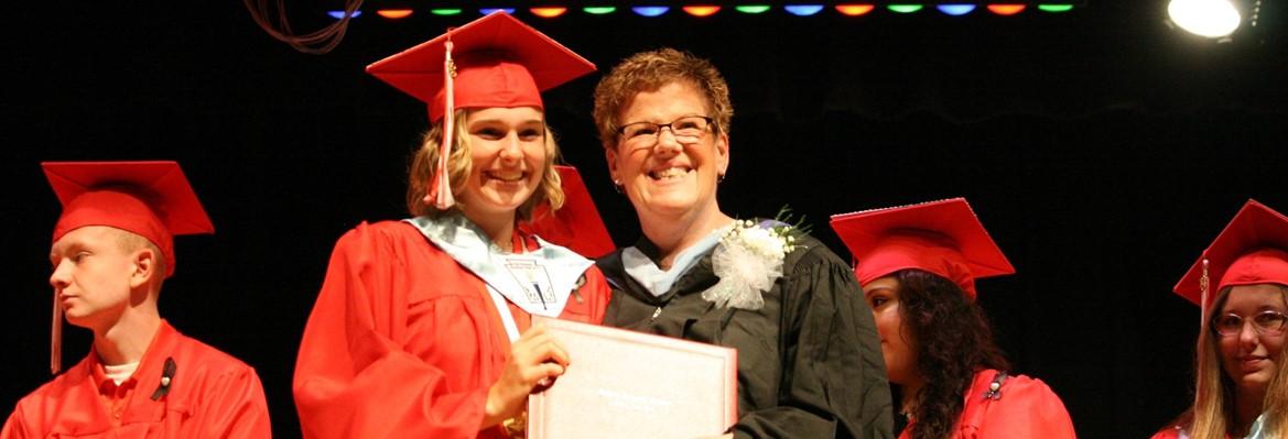 girl graduate with principal