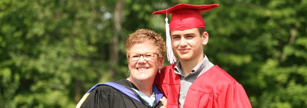 principal with boy graduate